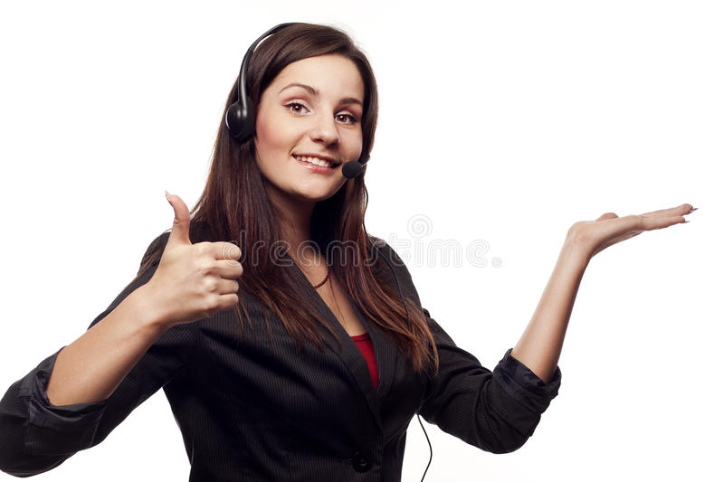 Woman operator with headset showing hand ok sign. Woman operator with headset close-up showing hand ok sign stock photos