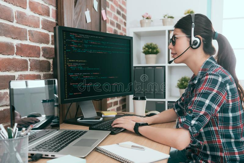 Woman operator monitoring customer computer royalty free stock photo