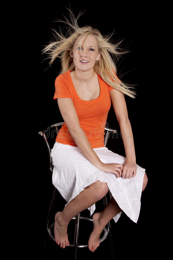 Download Woman Orange Chair Crazy Hair Stock Photo - Image: 18501282