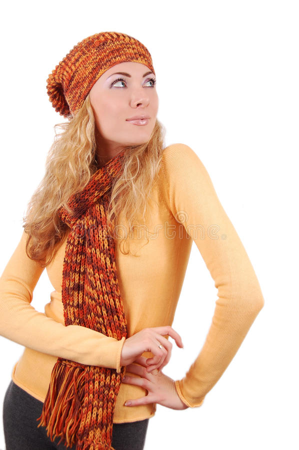 Woman in orange knitted hat, scar and sweater looking up stock photos