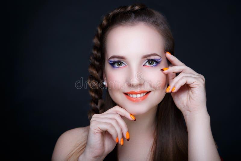 Woman orange nails stock photography