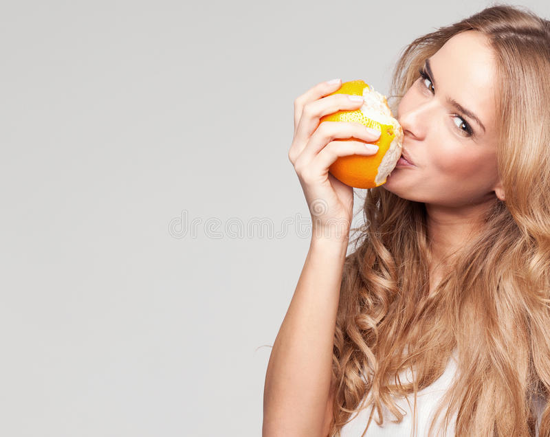 Download Woman with orange stock image. Image of domestic, health - 32250457