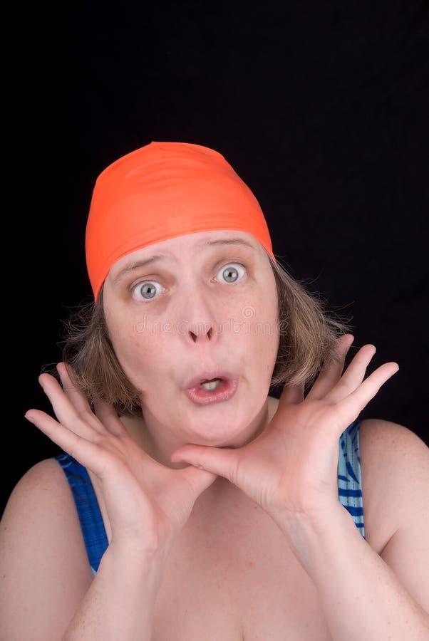 Woman with an orange swim cap royalty free stock image