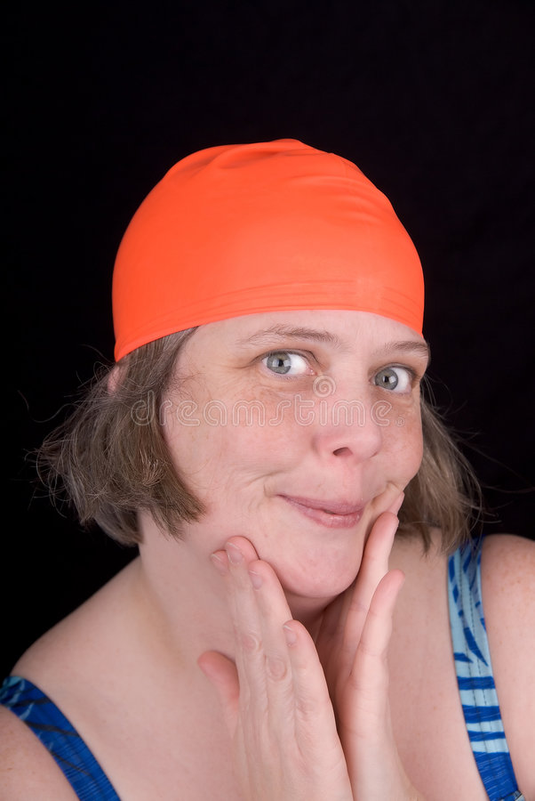 Woman with an orange swim cap. Making a funny faces royalty free stock images