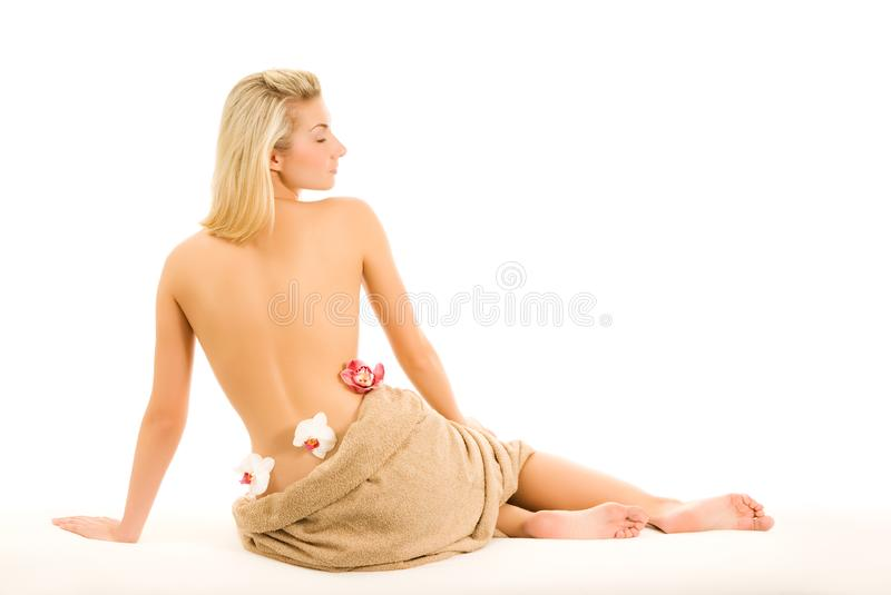 Woman with orchid flower stock image