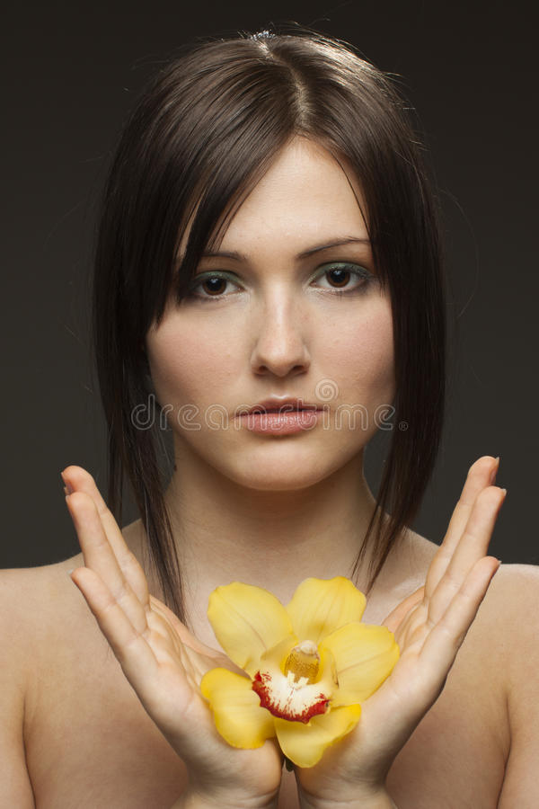 Download Woman With Orchid In Her Hands Stock Photo - Image: 22659026