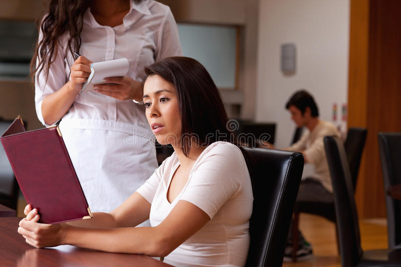 Woman ordering food. Women ordering food in a restaurant stock image