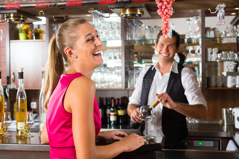 Download Woman Ordering Glass Of Wine At Bar Stock Image - Image of alcohol, order: 28557817