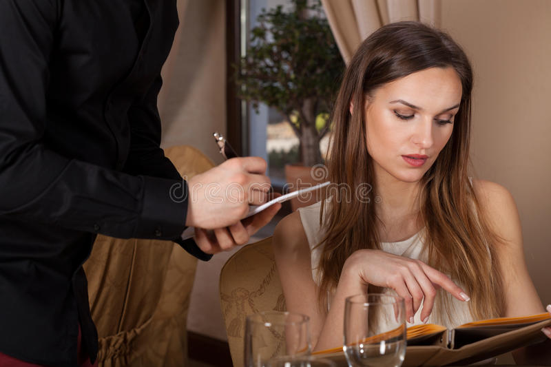 Woman ordering a meal. In a restaurant royalty free stock images