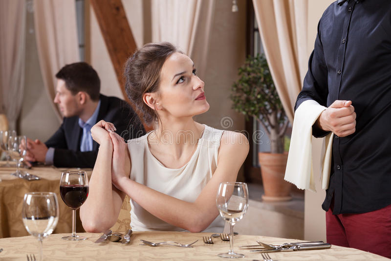 Woman ordering meal in a restaurant. Horizontal stock image