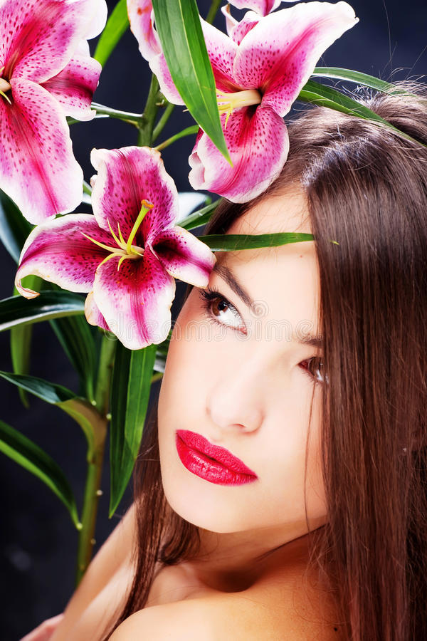 Woman With Oriental Flowers Royalty Free Stock Photography