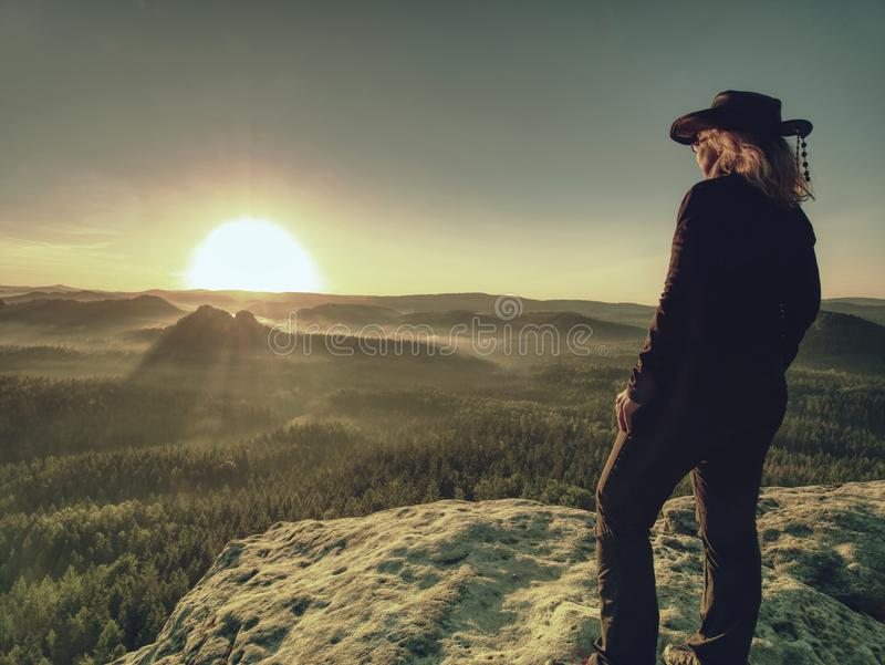 Woman in outdoor clothes  enjoy view at summit in mountains stock photos