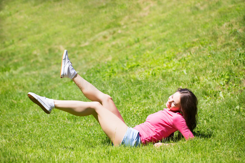 Woman in outdoor exercise smiling happy doing yoga. royalty free stock photography