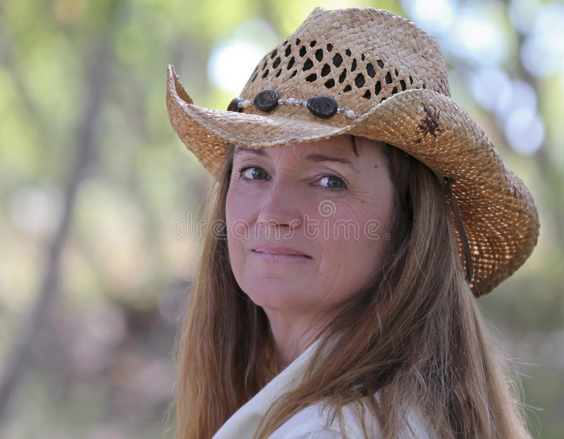 Download A Woman Outdoors In A Cowboy Hat Stock Photo - Image of eyes, faces: 21790430