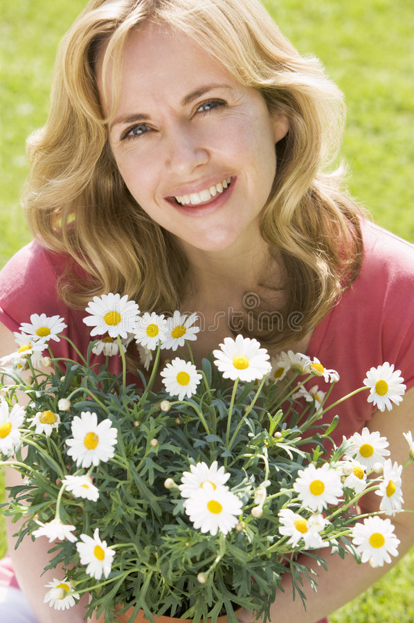 Download Woman Outdoors Holding Flowers Smiling Stock Photo - Image: 5935710
