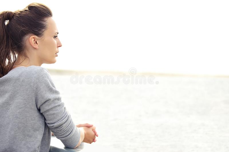 Woman Outdoors Looking Away stock photo