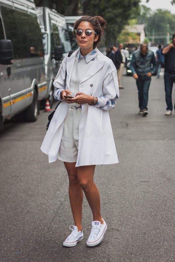 Woman outside Armani fashion shows building for Milan Women's Fashion Week 2014 royalty free stock photos