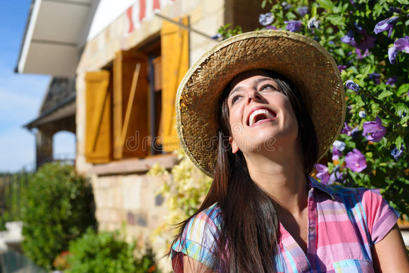Woman outside country house stock photography