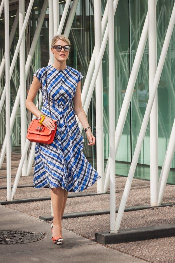 Woman outside Jil Sander fashion shows building for Milan Women's Fashion Week 2014 royalty free stock photo