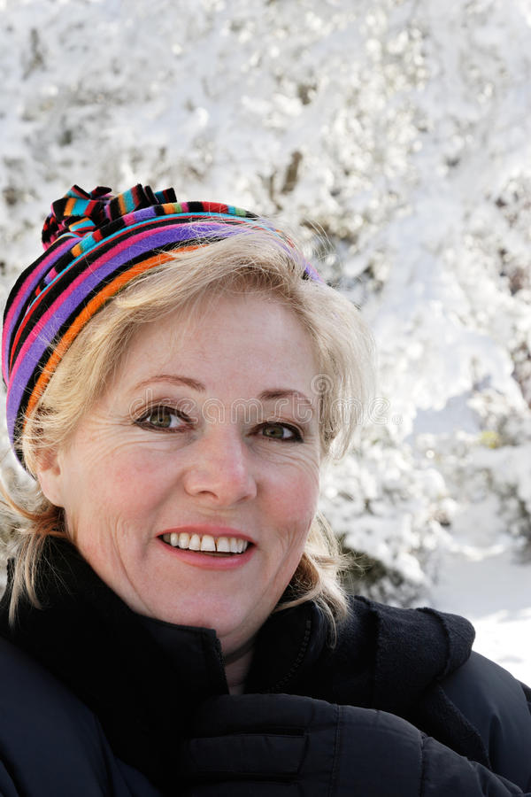 Woman outside on snowy day stock photography