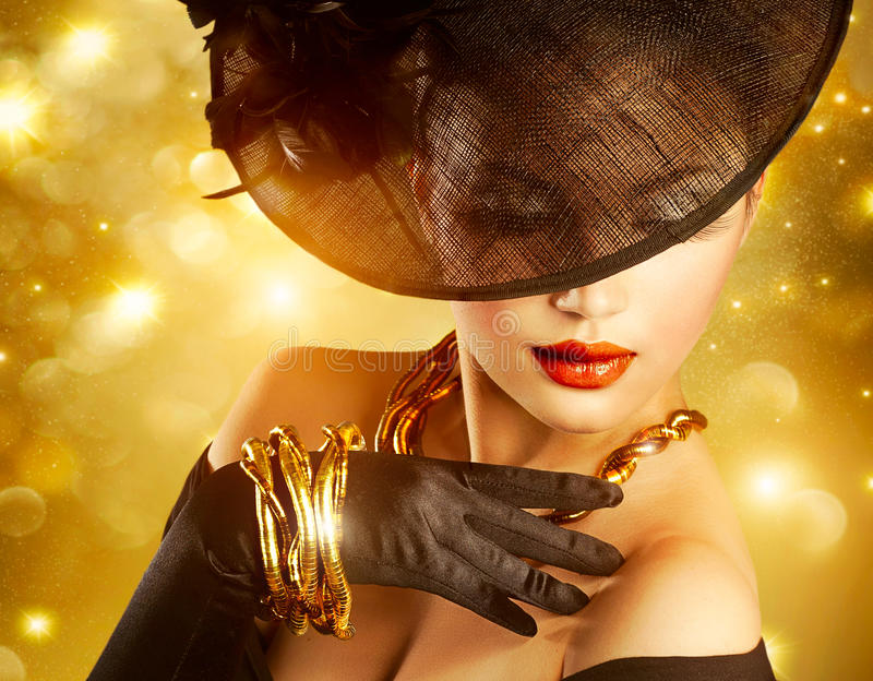 Woman over Golden Background. Luxurious Woman over Holiday Golden Background stock photo