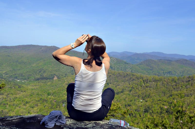 Woman on Overlook with Binoculars royalty free stock images