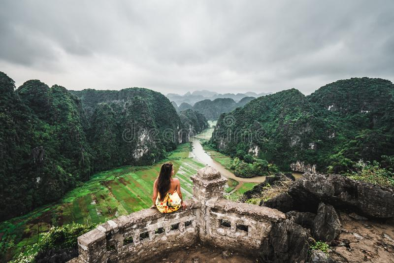 A woman overlooks the mountains of northern Vietnam from Hang Mua, a popular hiking destination. Asia stock photos