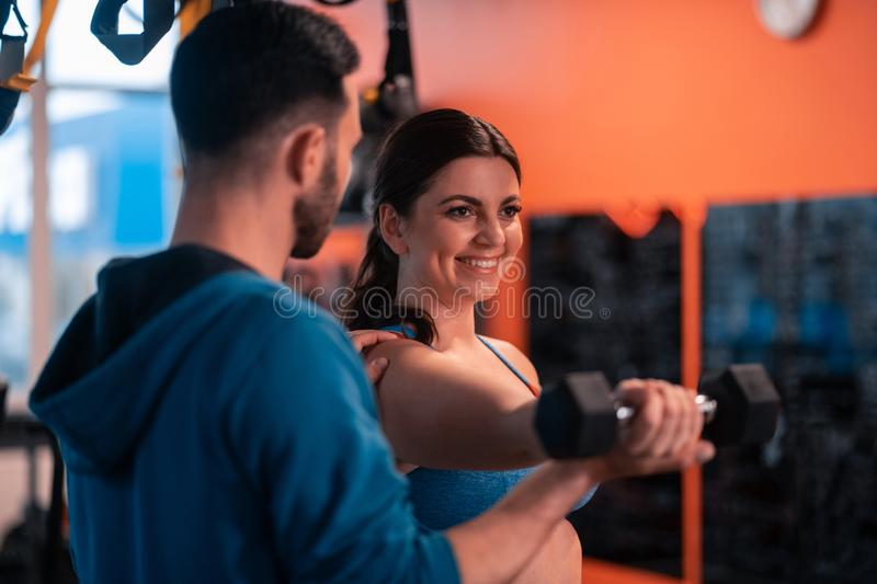 Woman with overweight feeling excited doing sport with coach royalty free stock images
