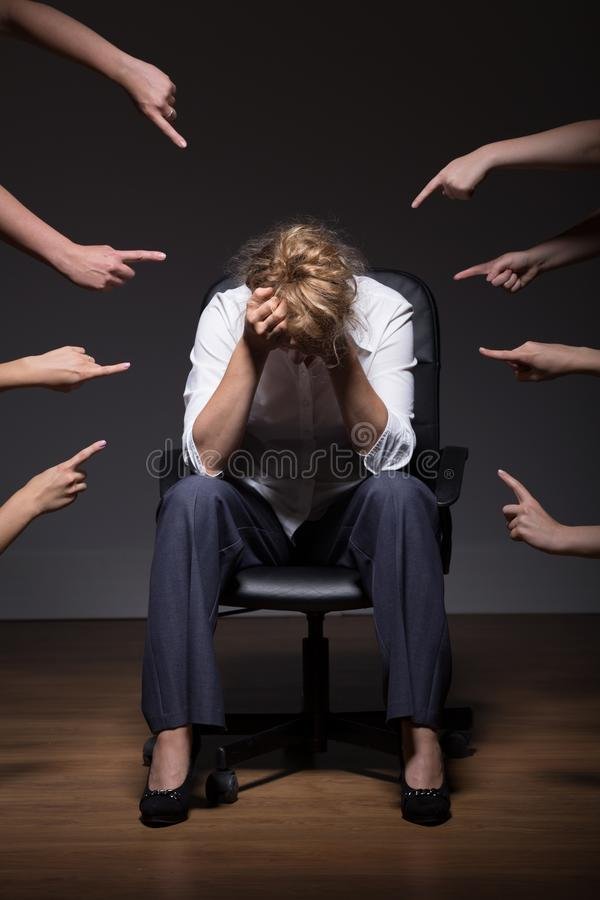 Woman overwhelmed at work stock images
