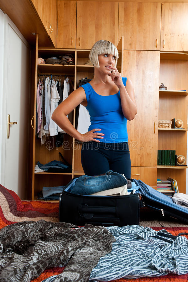 Download Woman packing clothes stock image. Image of baggage, female - 21227161