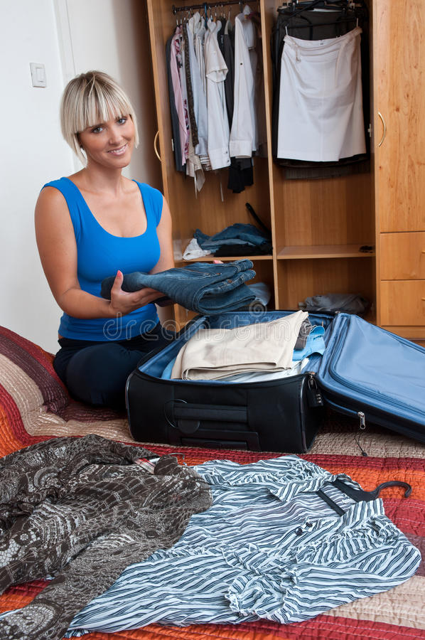 Download Woman packing clothes stock image. Image of beauty, person - 21227213