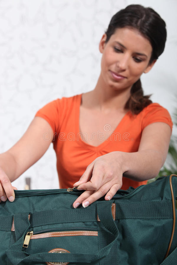 Download Woman packing green bag stock photo. Image of case, unpacking - 22536404