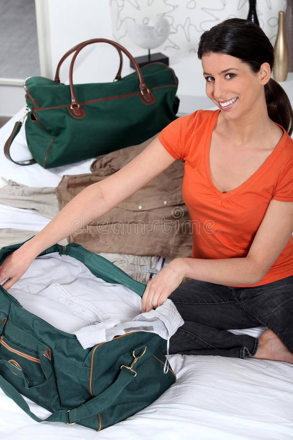 Download Woman Packing Her Bags Stock Photography - Image: 23021982