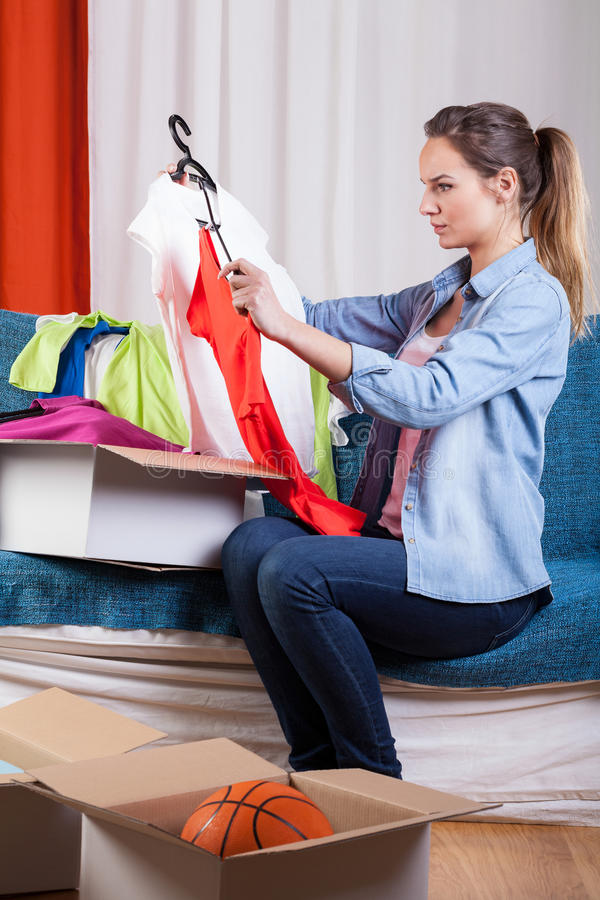 Woman packing her clothes stock photo
