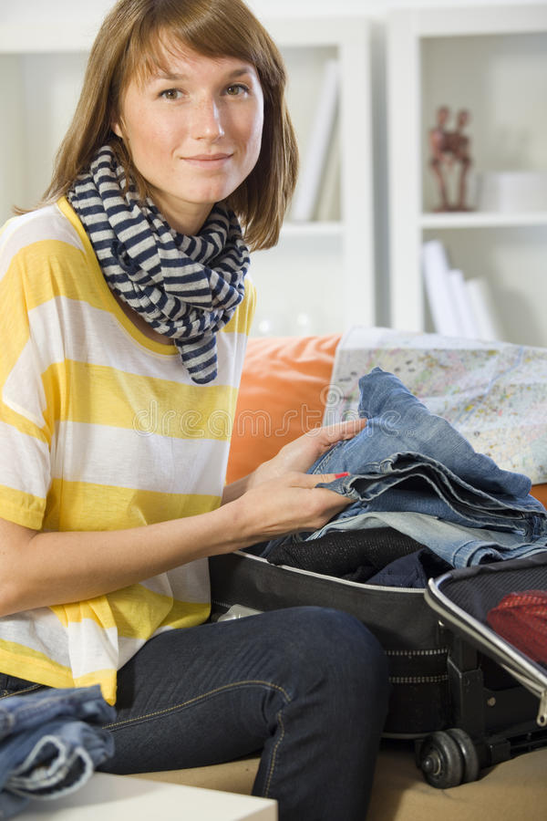 Download Woman packing her luggage stock photo. Image of clothes - 20381756