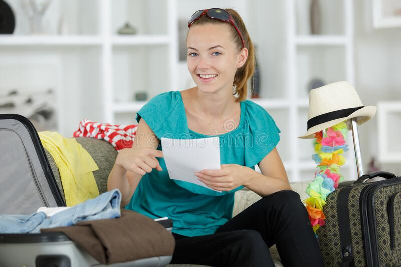 Woman packing luggage for new journey stock photo