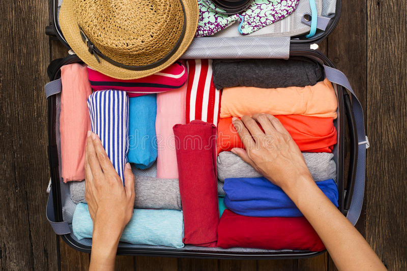 Woman packing a luggage for a new journey stock images