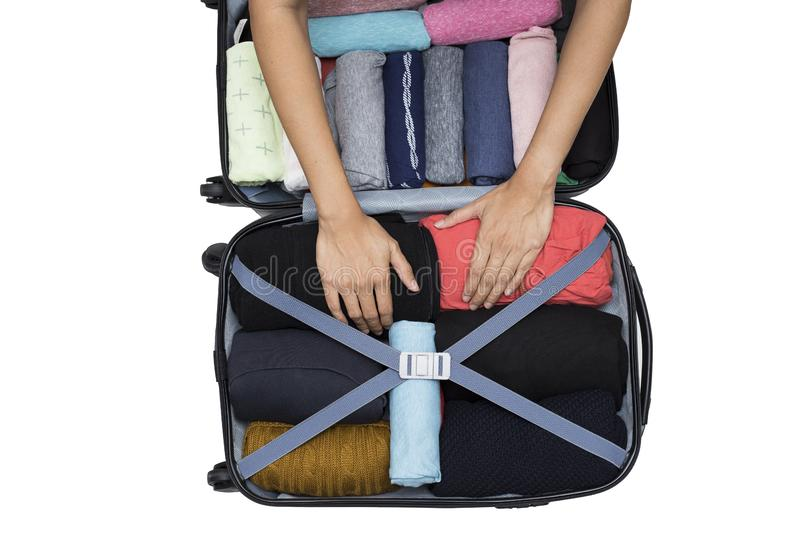 Woman packing a luggage for a new journey royalty free stock photo