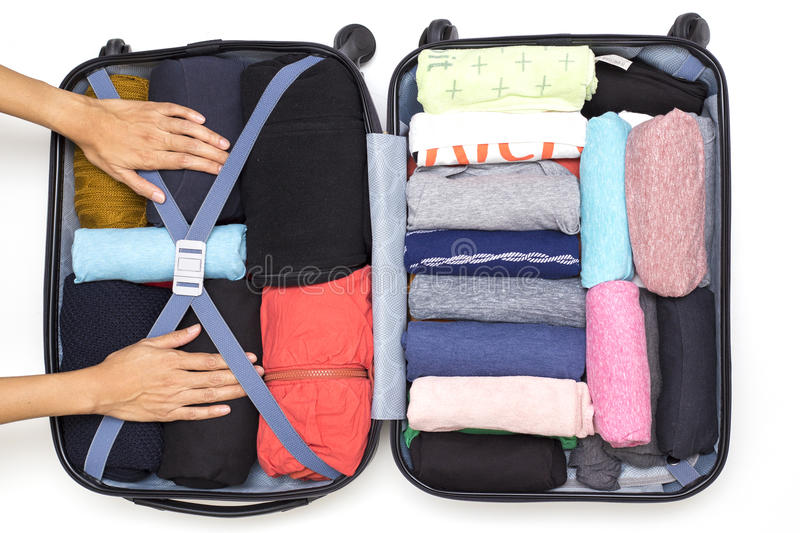 Woman packing a luggage for a new journey royalty free stock photos
