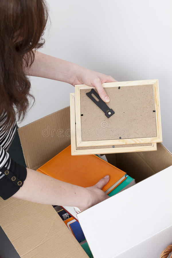 Woman packing photo frames stock photos