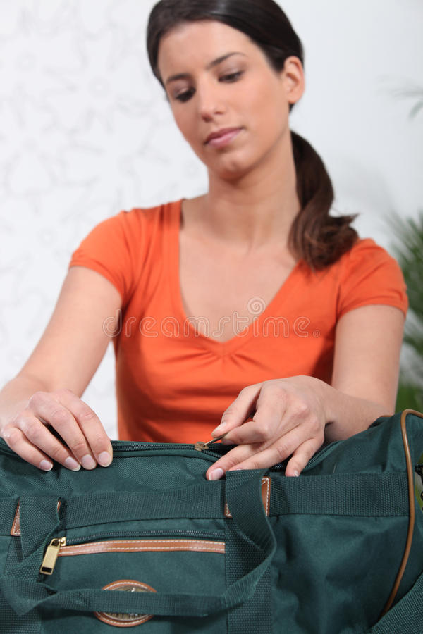 Download Woman packing travel bag stock image. Image of leisure - 23549711