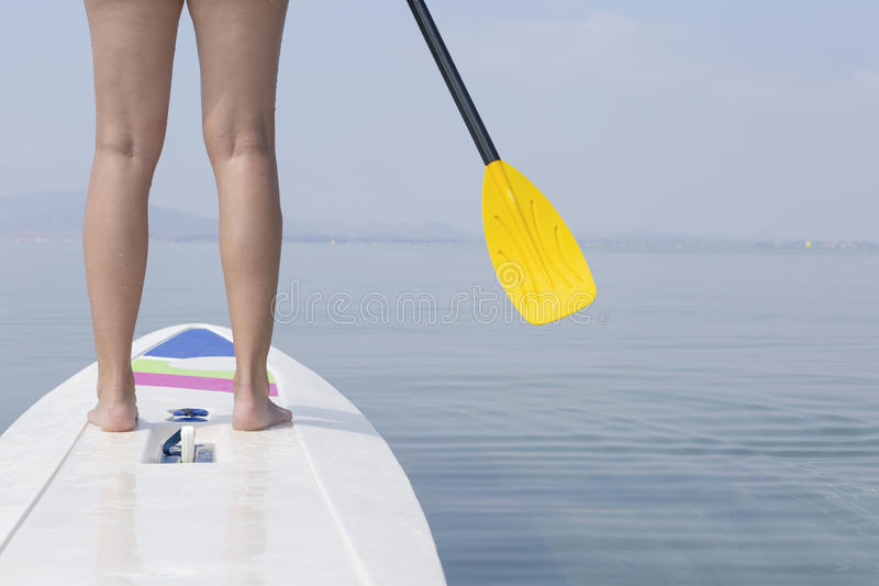 Woman and paddle board royalty free stock photo