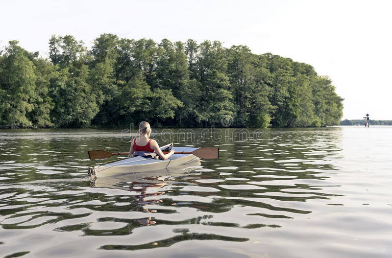 Woman in paddle boat stock photography