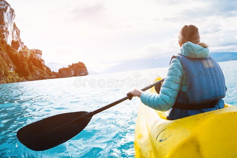 Woman paddles kayak royalty free stock photos