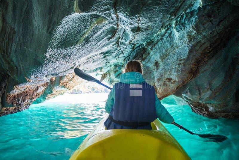 Woman paddles kayak royalty free stock images