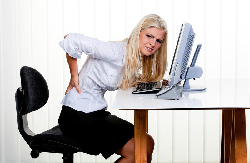 Woman With Pain In The Back Office Stock Image