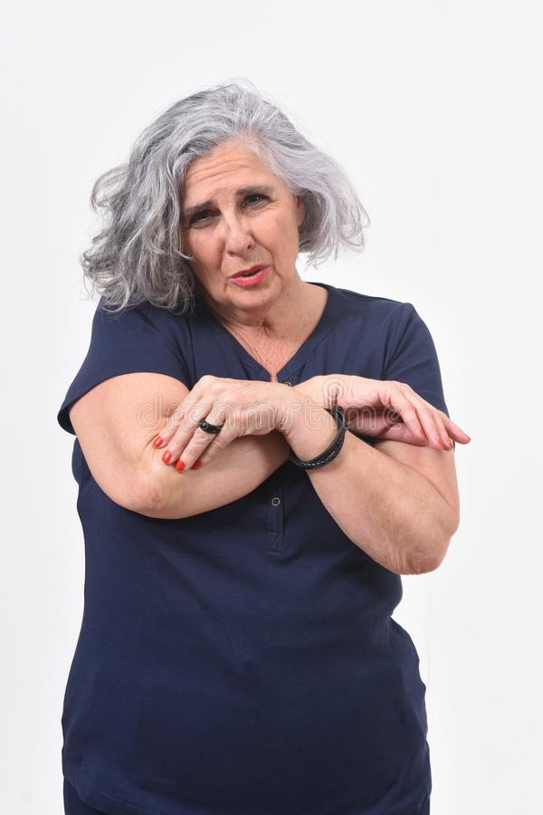 Woman with pain on elbow.  stock image