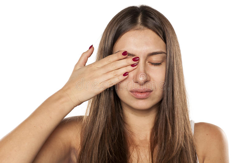 Woman with painful eye stock photography