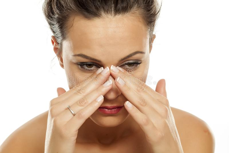 Woman with painful sinuses stock images