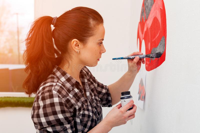 Woman paint little car royalty free stock images